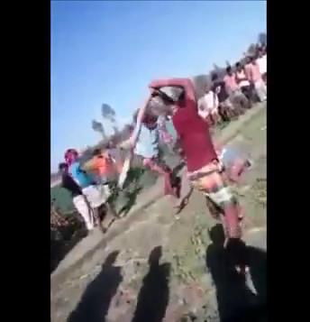 Villagers Watch Man being Beaten to Death With Big Sticks | theYNC->