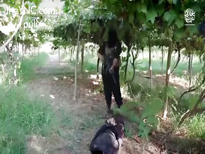 New ISIS Execution : beheading and Machine gun