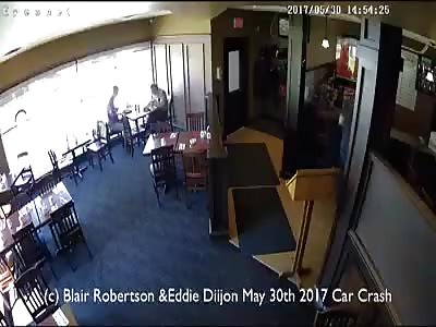 Car Smashes Through Restaurant Window